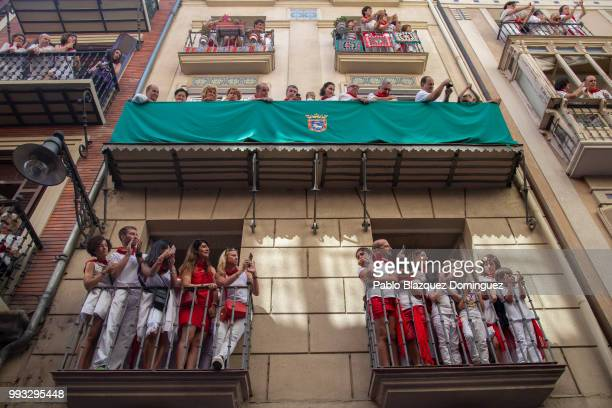 Revellers watch the San Fermin procession on the second day of the San Fermin Running of the Bulls festival on July 7 2018 in Pamplona Spain The...