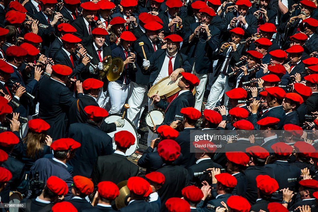 Revellers wave their arms as the band plays during the opening day or 'Chupinazo' of the San Fermin Running of the Bulls fiesta on July 6, 2015 in Pamplona, Spain. The annual Fiesta de San Fermin, made famous by the 1926 novel of US writer Ernest Hemmingway entitled 'The Sun Also Rises', involves the daily running of the bulls through the historic heart of Pamplona to the bull ring.