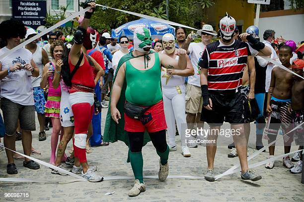 Revellers wear lucha libre outfits and engage in mock combat as part of the 'Enquanto isso na sala de justica' carnival parade which gathers hundreds...