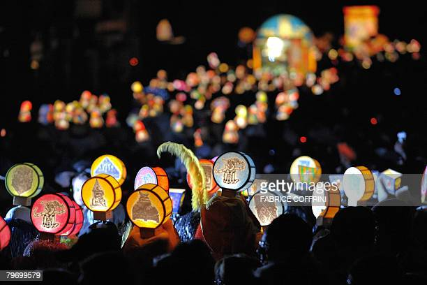 Revellers wearing lanterns parade through the streets of Basel during the traditional Morgestraich early February 11 2008 The carnival one of the...