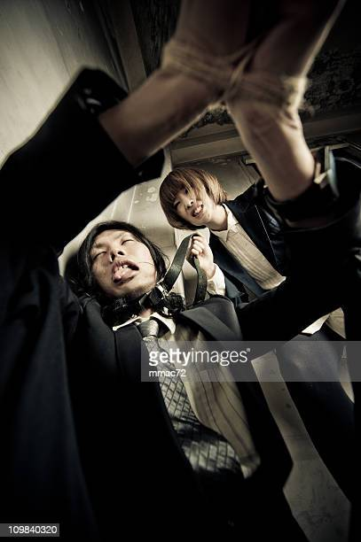 revenge - female torture stock photos and pictures