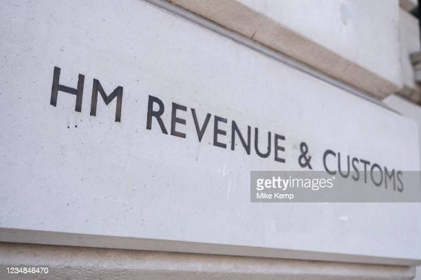 Revenue and Customs sign on Whitehall on 11th August 2021 in London, United Kingdom. HM Revenue & Customs also known as HMRC is in charge of all...