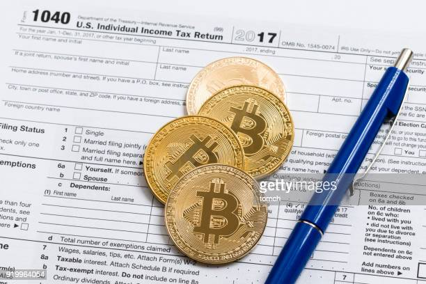 revenues from trading in the crypto-currency market - 1040 tax form stock photos and pictures