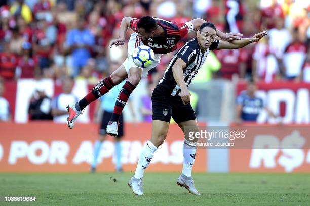 Rever of Flamengo struggles for the ball with Ricardo Oliveira of AtleticoMG during the match between Flamengo and AtleticoMG as part of Brasileirao...