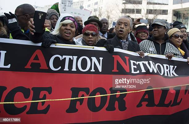 Reverend Al Sharpton and Lesley McSpadden mother of Ferguson shooting victim Michael Brown lead the Justice For All march in Washington DC December...