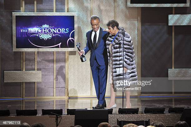Reverend Al Sharpton and musician Aretha Franklin appear onstage at BET Honors 2014 at Warner Theatre on February 8 2014 in Washington DC