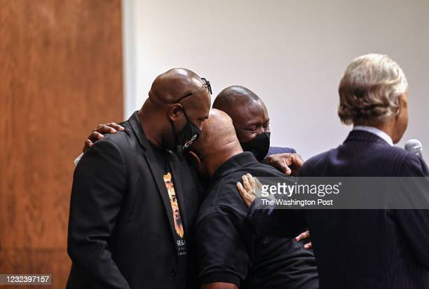 Reverend Al Sharpton , places his hand on the back of an emotional Terrence Floyd as he is embraced by his brother Philonise Floyd and attorney...