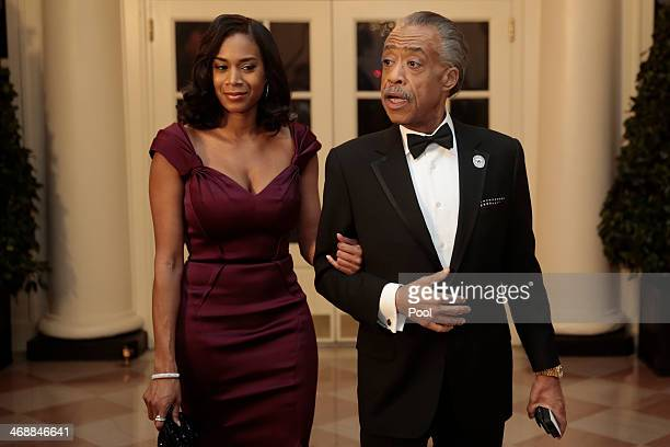 Reverend Al Sharpton right and Aisha I McShaw arrive to a state dinner hosted by US President Barack Obama and US first lady Michelle Obama in honor...
