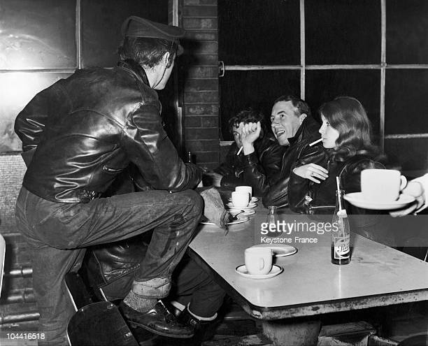 Reverend Bill SHERGOLD a blackleatherjacket wearing pastor talking with young people in a cafe to try to understand what it is about motorcycle...