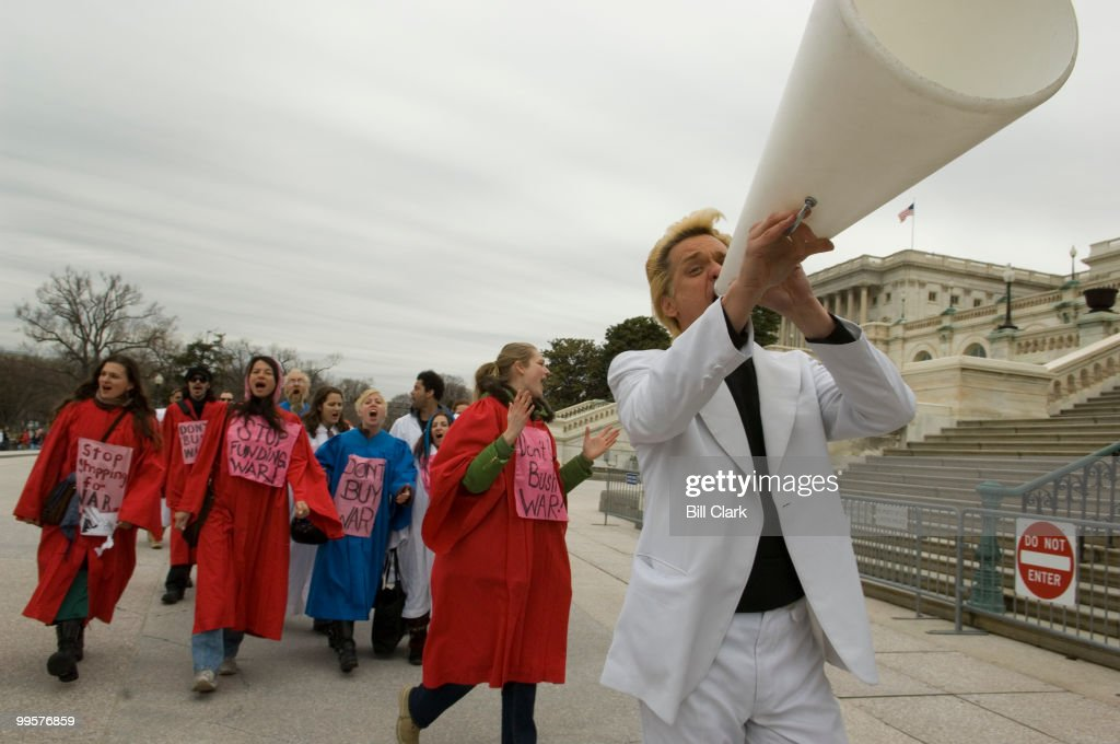 Reverend Billy and the Stop Shopping Gospel Choir cross the west front of the Capitol on their way to the Rayburn House Office building cafeteria as Code Pink continued their daily protests against the war in Iraq this week on Wednesday, March 21, 2007. The Church of Stop Shopping is a non profit group based in New York that fights against consumerism.