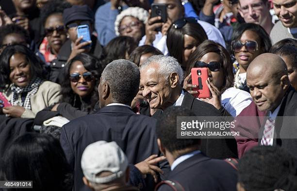 Reverend C. T. Vivian arrives for an event at the Edmund Pettus Bridge on March 7, 2015 in Selma, Alabama. US President Barack Obama and the first...