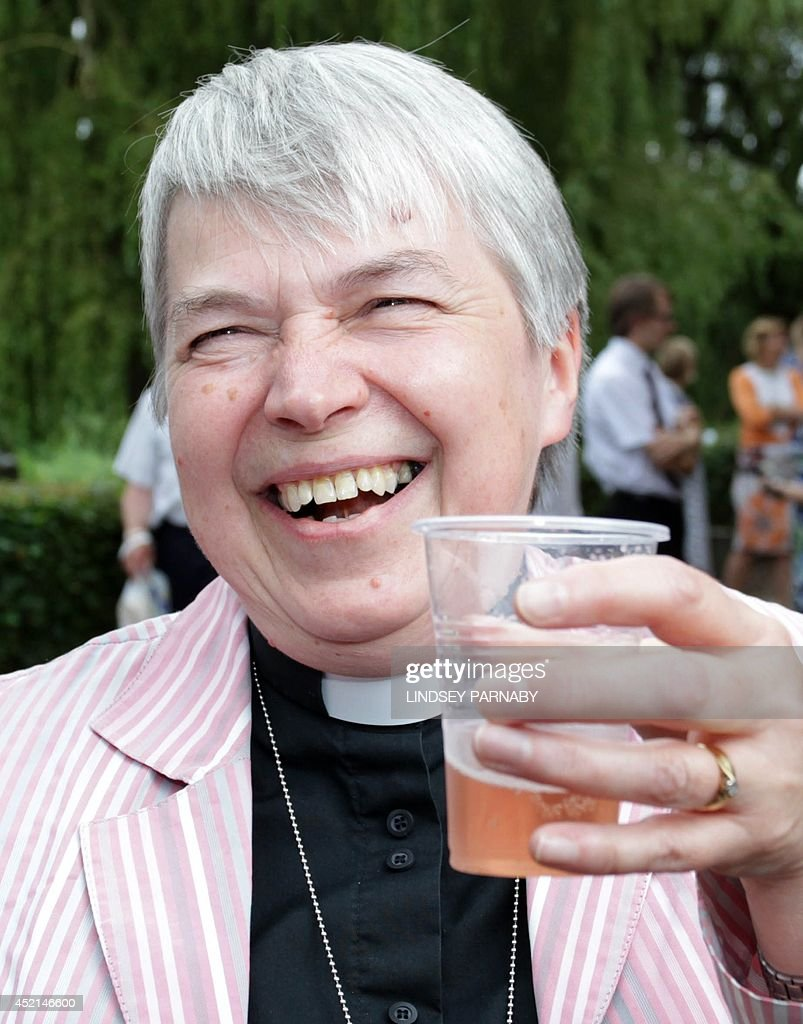 Reverend Canon Joyce Jones of Wakefield celebrates with a drink outside the venue after members voted to approve the creation of female bishops at the Church of England General Synod in York, northern England, on July 14, 2014. The Church of England overcame bitter divisions on July 14 to vote in favour of allowing female bishops for the first time in its nearly 500-year history. The decision reverses a previous shock rejection in 2012 and comes after intensive diplomacy by Archbishop of Canterbury, Justin Welby.