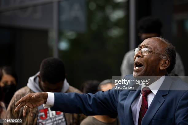 Reverend Charles Elliott speaks as protesters gather for a peaceful march on May 29, 2020 in Louisville, Kentucky. Protests have erupted after recent...