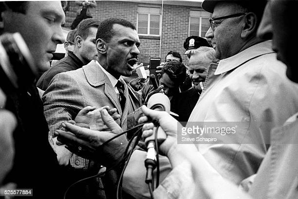 Reverend C.T. Vivian confronts Sheriff Jim Clark while the news media observes and records during the Selma Civil Rights March. Sheriff Clark was one...