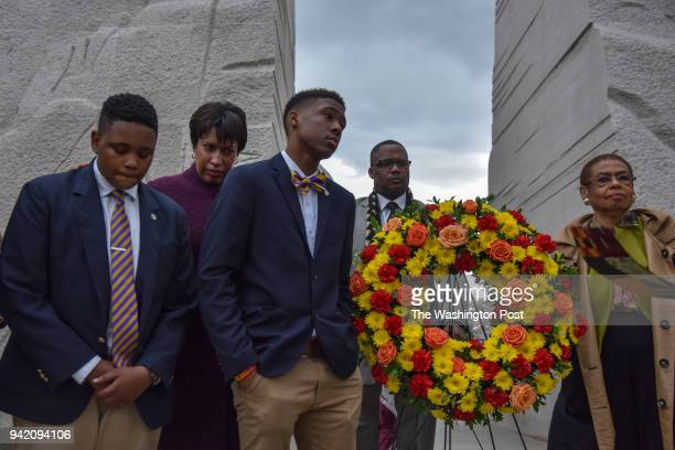 Reverend Dr Martin Luther King Jr is honored at the site of his DC memorial as DC Mayor Muriel Bowser 2nd from L hosts a ceremonial wreath laying on...