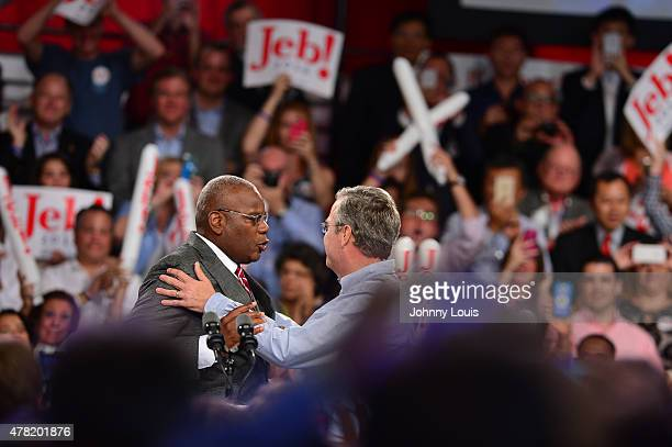 Reverend Dr. R. B. Holmes, Jr. Shake Jeb Bush hand after speaking to the crowd. Former Republican Governor of Florida Jeb Bush announces his...