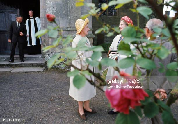 Reverend Eric Andrews bidding farewell to parishioners following a service at the parish church of St Mary the Virgin in Pembridge, England, circa...