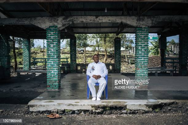 Reverend Etienne Mupini Kisimba Meki, head of the Kimbanguist church in Goma, poses for a photograph on March 22 in his church deserted by the...