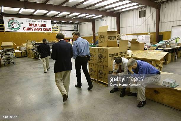 Reverend Franklin Graham walks through a warehouse at the headquarters of his organization Samaritan's Purse on June 6 2003 in Boone North Carolina...