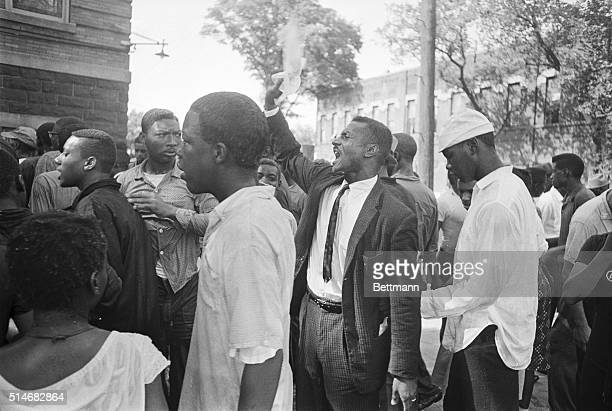 Reverend Fred Shuttleworth speaks to a group of African American protesters after a segregation protest was disrupted by people throwing rocks and...