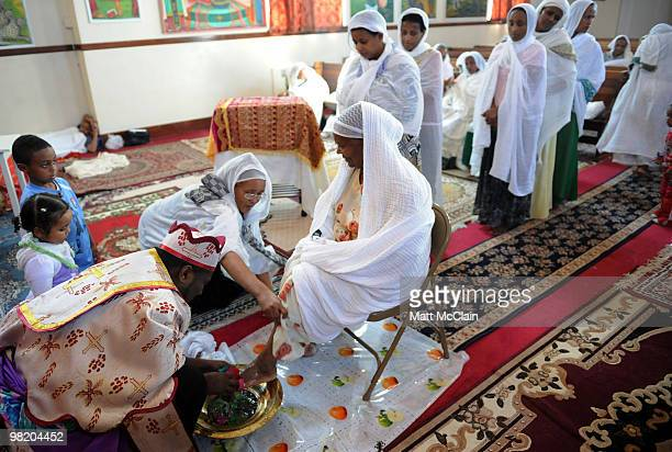 Reverend Gebrekiros washes the feet and hands of parishioners at the Ethiopian Orthodox Church April 1 2010 in Denver Colorado Members of the...
