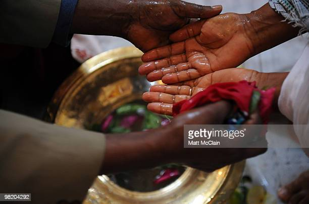Reverend Gebrekiros washes the hands and feet of parishioners at the Ethiopian Orthodox Church April 1 2010 in Denver Colorado Members of the...