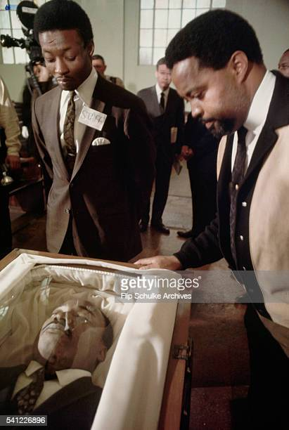 Reverend Hosea Williams and another man view the body of Martin Luther King Jr before his memorial service in Ebenezer Baptist Church