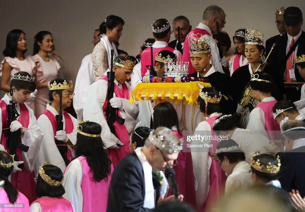 World Peace And Unification Sanctuary Religious Group Holds Blessing Ceremony For Couples And Their AR-15 Rifles : News Photo