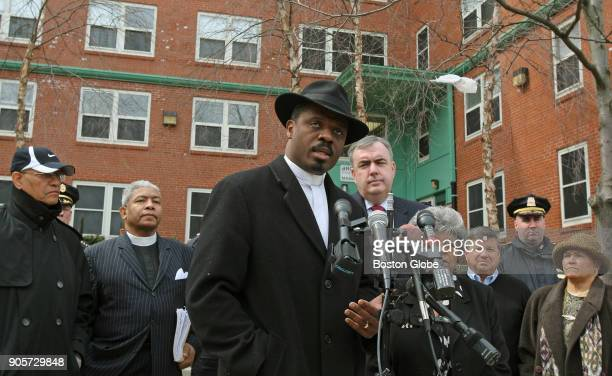 Reverend Jeffrey Brown addresses media as Boston Police Commissioner Ed Davis listens at right in the Bromley Heath housing development in the...