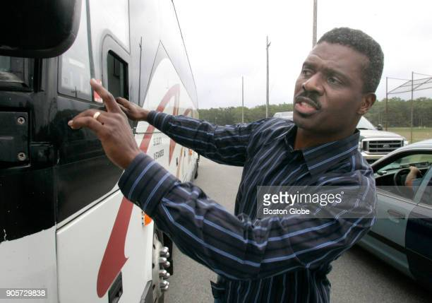 Reverend Jeffrey Brown directs a bus arriving from his church the Union Baptist Church in Cambridge delivering donated clothing inside the housing...