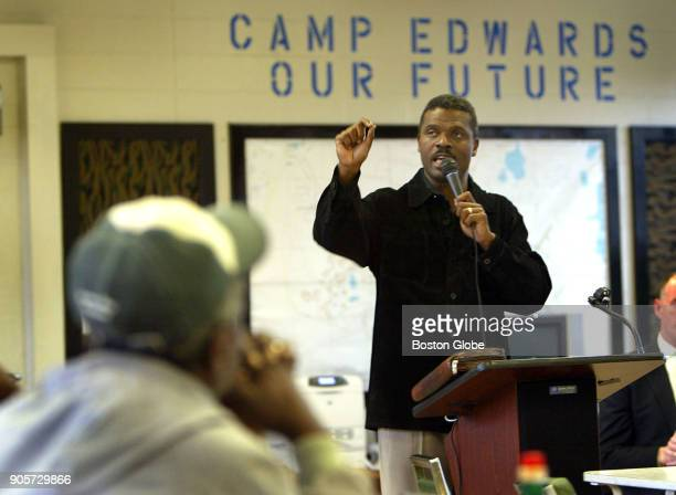 Reverend Jeffrey Brown speaks to some of the remaining Hurricane Katrina evacuees at a community town meeting held in the village cafeteria at Camp...