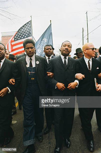 Reverend Jesse Douglas Reverend Martin Luther King and James Forman leading the march from Selma to Montgomery to protest lack of voting rights for...
