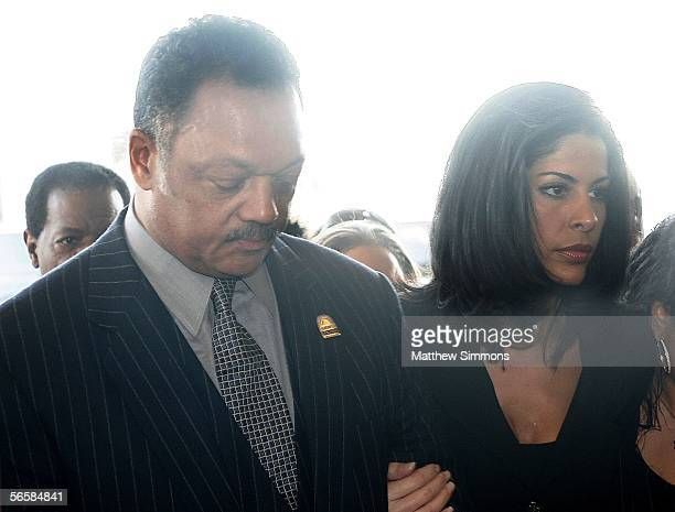 Reverend Jesse Jackson and Lou Rawls widow Nina Malek Inman arrive to a funeral service for musician Lou Rawls at the West Angeles Church of God in...