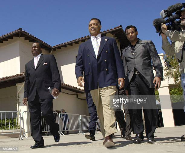 Reverend Jesse Jackson and others leave Santa Barbara County Superior Court after speaking with the media about Michael Jackson and his child...