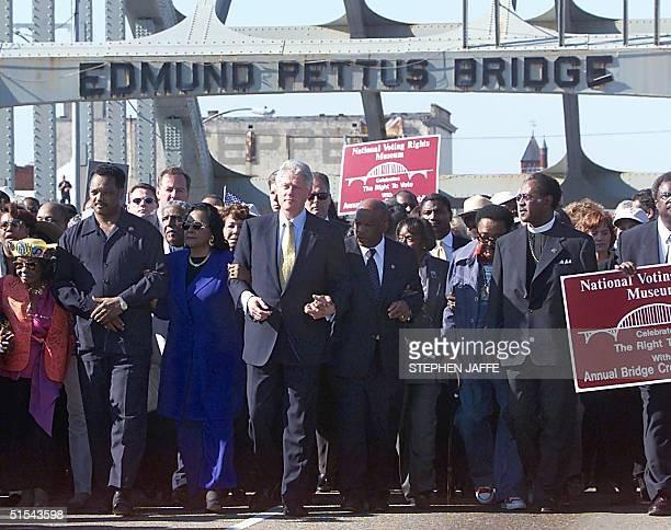 Reverend Jesse Jackson Coretta Scott King US President Bill Clinton and US Rep John Lewis walk armandarm over the Edmund Pettus Bridge 05 March 2000...