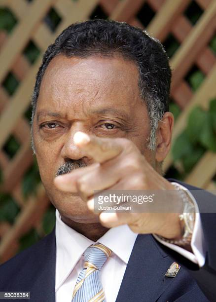 Reverend Jesse Jackson gestures as he speaks to the media outside the Santa Barbara County Superior Court about Michael Jackson and his child...