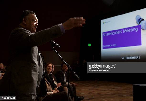 Reverend Jesse Jackson gestures toward the stage after asking a question during the Microsoft Shareholders Meeting December 3 2014 in Bellevue...