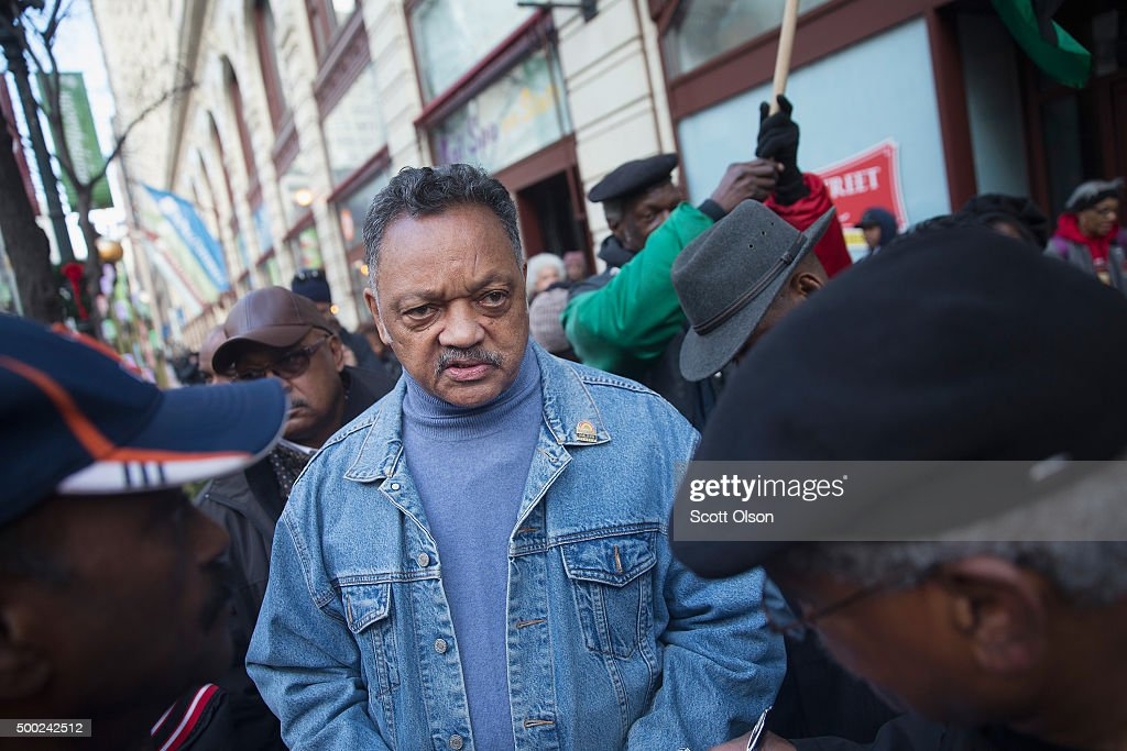 Reverend Jesse Jackson leads demonstrators down State Street to protest the death of Laquan McDonald and the alleged cover-up that followed on December 6, 2015 in Chicago, Illinois. Chicago Police officer Jason Van Dyke shot and killed 17-year-old McDonald on October 20, 2014, hitting him with 16 bullets. Van Dyke was charged with murder more than a year after the shooting after a judge ordered the release to the public of a video which showed McDonald backing away from Van Dyke while being shot.