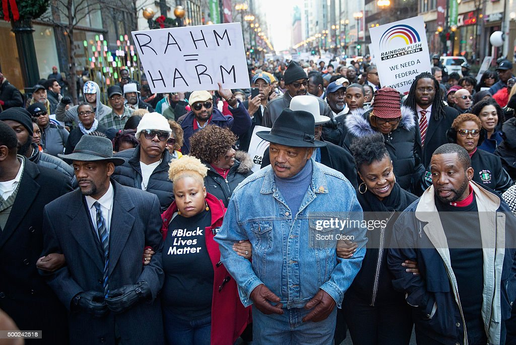 Reverend Jesse Jackson (C) leads demonstrators down State Street to protest the death of Laquan McDonald and the alleged cover-up that followed on December 6, 2015 in Chicago, Illinois. Chicago Police officer Jason Van Dyke shot and killed 17-year-old McDonald on October 20, 2014, hitting him with 16 bullets. Van Dyke was charged with murder more than a year after the shooting after a judge ordered the release to the public of a video which showed McDonald backing away from Van Dyke while being shot.