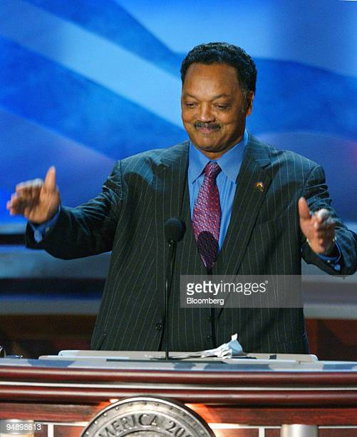 Reverend Jesse Jackson leads the crowd in a cheer for John Kerry during the third session of the Democratic National Convention in Boston...