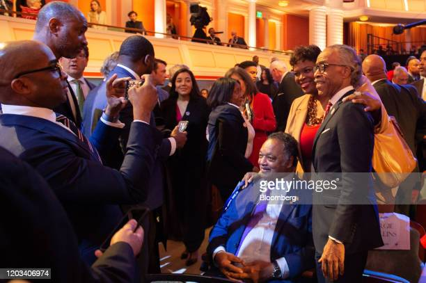 Reverend Jesse Jackson president and founder of the Rainbow PUSH coalition center right and Reverend Al Sharpton right attend the Democratic...