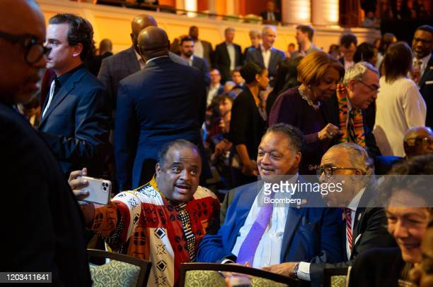 Reverend Jesse Jackson president and founder of the Rainbow PUSH coalition center and Reverend Al Sharpton right attend the Democratic presidential...