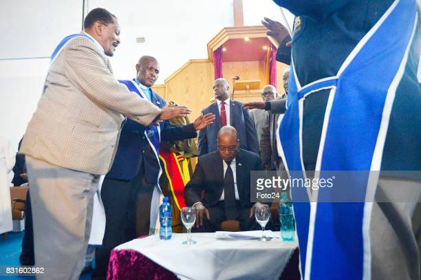 Reverend John Molefe Moloi Arch Bishop Daniel Mathe and President Jacob Zuma at the St John Apostolic Church on August 12 2017 in Johannesburg South...