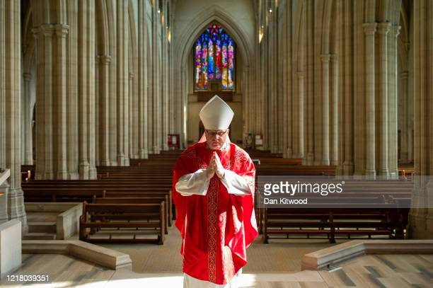 Reverend John Wilson, Catholic Archbishop of Southwark delivers the Solemn Liturgy of the Passion on Good Friday, to an empty St Georges Cathedral on...