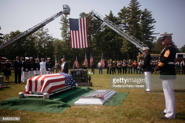 Reverend Leslie Hatfield speaks to Capt Ben Cross' family and friends as he is laid to rest at Riverside Cemetery Cross was one of the Marines killed...