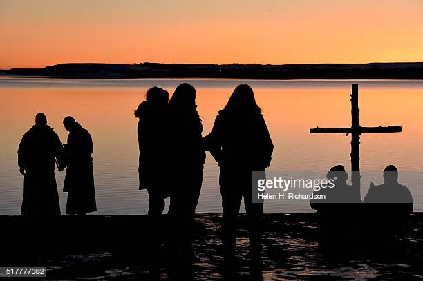 Reverend Martin Lettow far left and Reverend Mark Twietmeyer second from left prepare for the 21st annual Easter sunrise celebration service as...