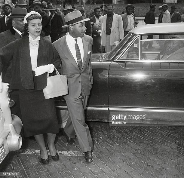 Reverend Martin Luther King Jr and his wife Coretta Scott King cross the street near the Montgomery County Court House during a recess his trial King...