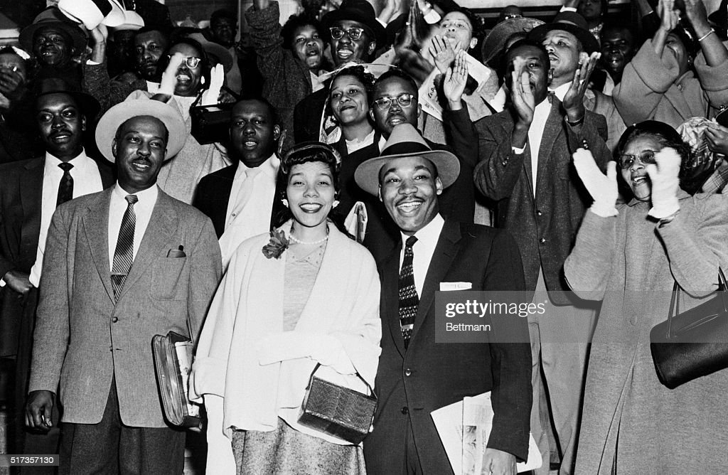 Reverend Martin Luther King Jr. and his wife Coretta Scott King (C) smile broadly as they stand in front of a group of cheering followers after King's conviction for his part in the bus boycott in Montgomery, Alabama.