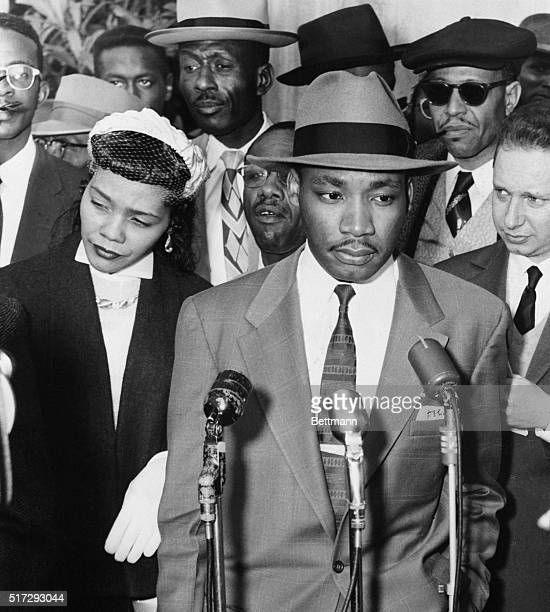 Reverend Martin Luther King Jr and his wife Coretta Scott King speak to reporters on the steps of the Montgomery County Court House before the...