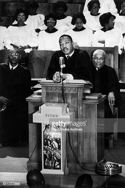 Reverend Martin Luther King Jr delivers a sermon to the congregation at Ebenezer Baptist Church His father Martin Luther King Sr and the choir listen...